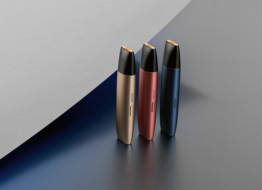 3 colours of VEEV vaping devices on a grey and blue background